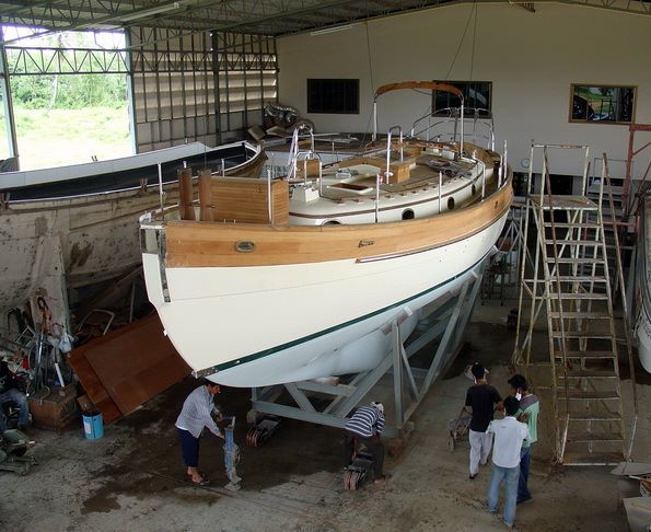 A new Hans Christian 41 Traditional receiving final fitting out at Pantawee Marine Co., Ltd. near Pattaya, Thailand. Courtesy of BlueWaterBoats.org and Francis Mertens.